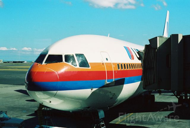 McDonnell Douglas DC-10 — - United DC-10 parked at gate at PHNL, 1990