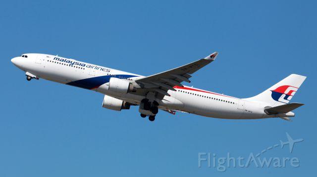 Airbus A330-300 (9M-MTG) - Departing 34L