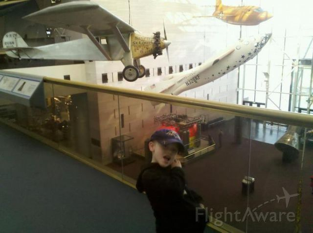 — — - My son in front of the Spirit of St Louis at the National Air and Space Museum in Washington, DC.