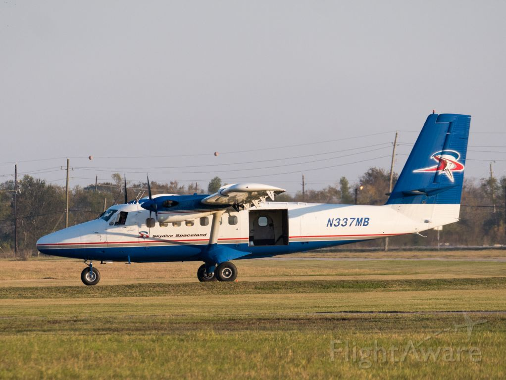 De Havilland Canada Twin Otter (N337MB) - Skydive Spaceland DHC6 taxiing back to hangar after dropping skydivers