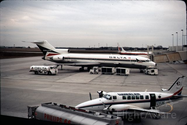 Boeing 727-100 (N520DA) - Delta 727 being refueled by a truck at CLT.  Note United B737 in background and commuter aircraft in foreground.