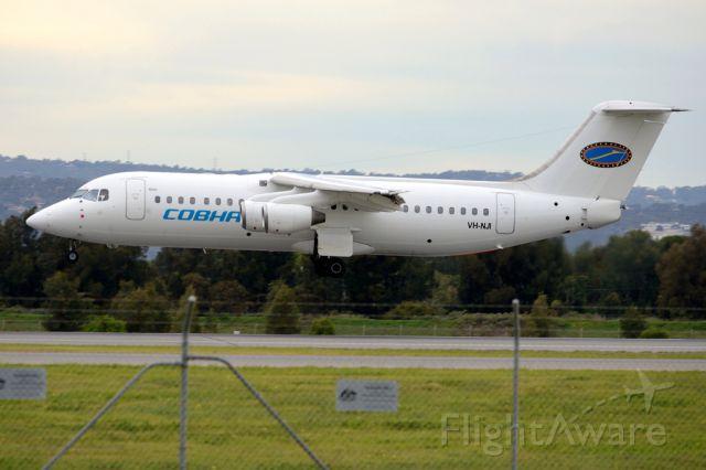 Avro RJ-100 Avroliner (VH-NJI) - About to put down on runway 05. Thursday, 19 June 2014.