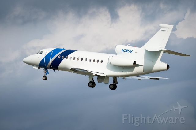 Dassault Falcon 2000 (N18CG) - Departing Hickory Rwy 6 with weather to the southeast.12.Jul.2010