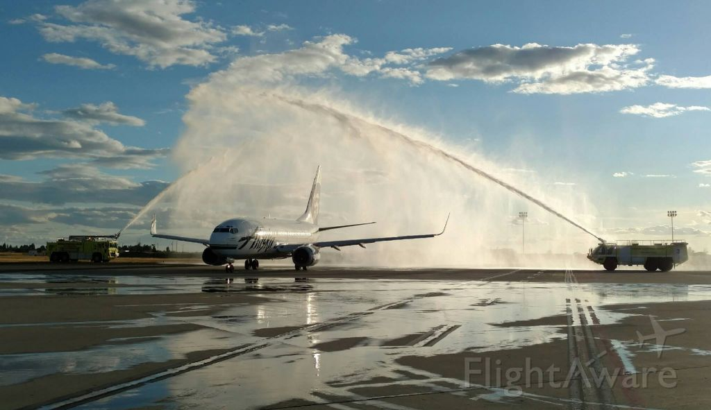 Boeing 737-700 (N612AS) - Throwback to 2016 for the inaugural flight to Anchorage. This Alaska Airlines Boeing 737-700 gets a special water cannon salute prior to departure. It was scheduled to be a  seasonal weekend only flight. But as of now, there are no more nonstop flights.