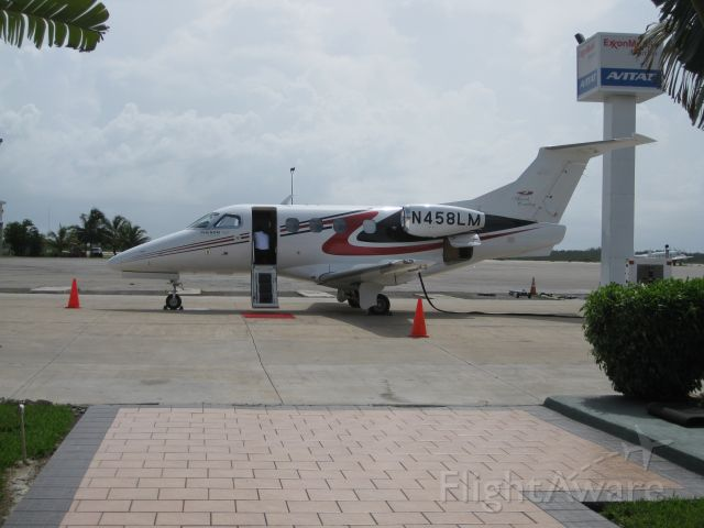Embraer Phenom 100 (N458LM) - Phenom 100 Embeare see on Bahamas for demostration on 4th of July 2009 3M not bad.