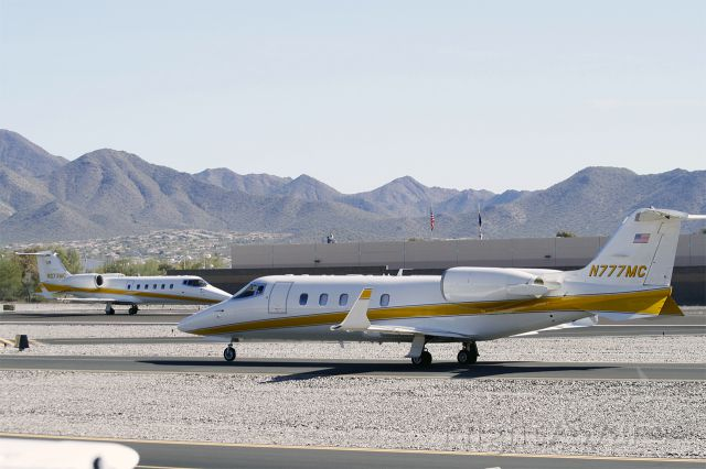 Learjet 60 (N777MC) - N777MC, and its twin N273MC departing Scottsdale Airport.