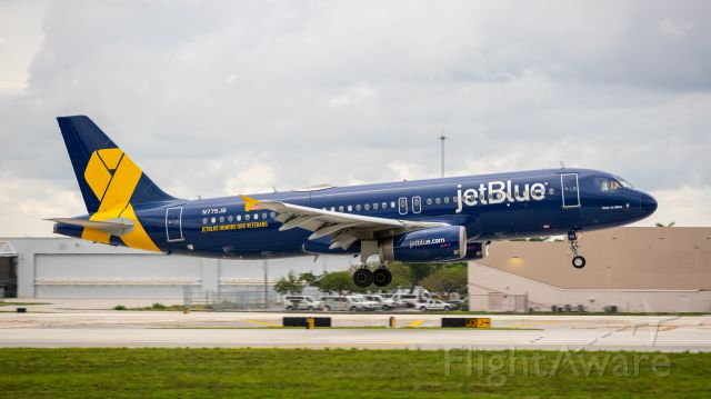 """Airbus A320 (N775JB) - Jetblue A320 """"Jetblue Honors our Veteran"""" livery landing on runway 10R"""