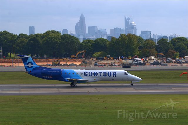 N27512 — - 27512 taking off on Rwy 18C with the Charlotte skyline in the background