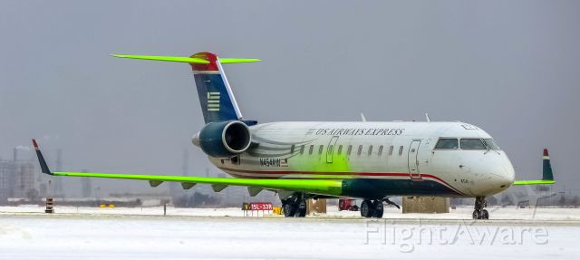 Canadair Regional Jet CRJ-200 (N454AW) - Wearing a beautiful winter jacket that not too many people have seen.