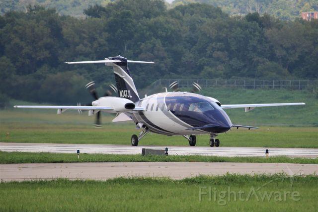 Piaggio P.180 Avanti (N247JL) - Arriving home on runway 25 at Lunken.