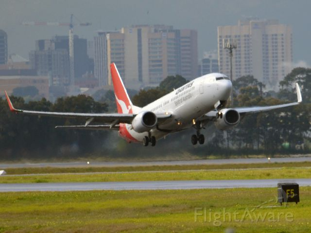 Boeing 737-800 (VH-VYF) - Getting airborne off runway 23 on a gloomy, cold winter