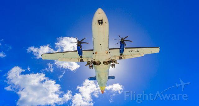 V2-LIK — - Liat over maho beach for landing at TNCM St Maarten.