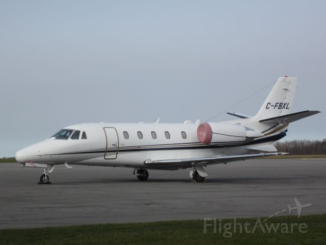 Cessna Citation Excel/XLS (C-FBXL) - Nice Airsprint jet sitting on the tarmac at Kingston.  The intake covers do seem a bit faded though