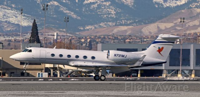 """Gulfstream Aerospace Gulfstream IV (N721MJ) - A capture I never really expected to get. Maui Jim's """"Aloha One"""" (N721MJ) has the mains on the runway as it lands on 16R. """"Aloha One"""" was another of the awesome aircraft that paid a visit to Reno last weekend."""