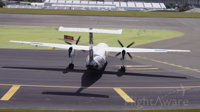 """de Havilland Dash 8-300 (ZK-NFI) - Note the aircraft is positioned sideways to avoid the wind blowing into the engines as turboprops """"do not like it"""""""