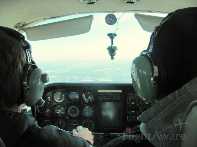 Beechcraft Sundowner (N6664N) - Flying over northeast Illinois.