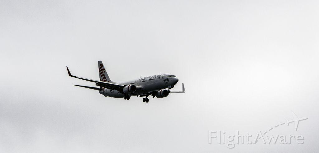 Boeing 737-800 (VH-YIT) - Virgin inbound to The Sunshine Coast Airport. Taken from Point Perry, Coolum Beach
