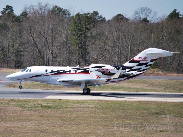 Cessna Citation X (N1JM) - CESSNA FINANCE CORPORATION (NASCAR driver Jamie McMurray) arriving runway 20 at KJQF - 3/14/14