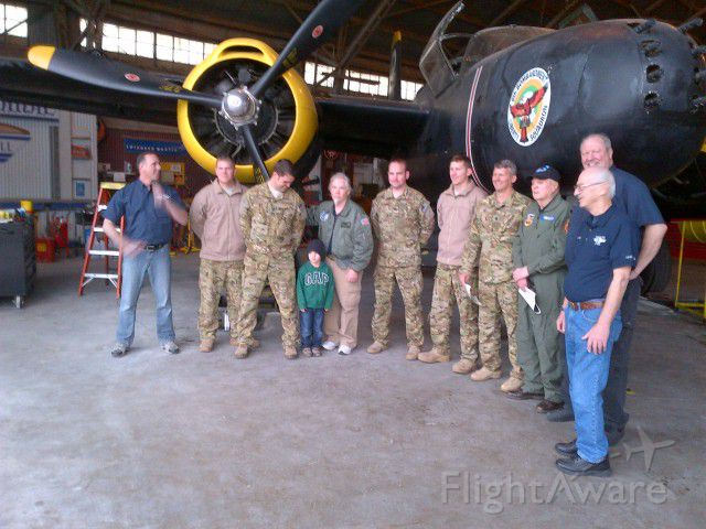 — — - CV-22 crew members from the 8Th SOS stopped by to meet the CAF A26 Invader. Little man was presented a set of wings by the Capt looking down at him. Thats Joe Maynard in green flight suit, based out of NKP back in the day.  Joe was Aircraft Commander in A26-K with 105 missions over the HCM trail