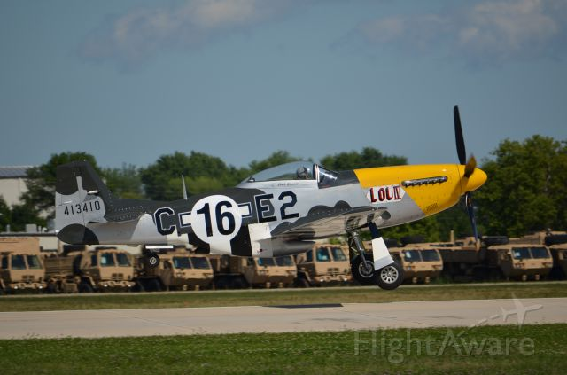 """North American P-51 Mustang — - EAA 2011 P-51D """"Lou IV"""" on take off."""