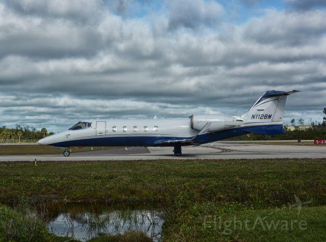 Learjet 60 (N1128M)