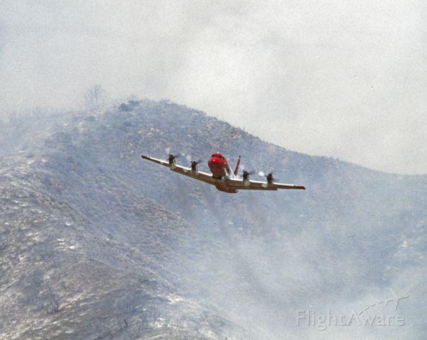 N927AU — - Airtanker 27 Climbing after a drop.