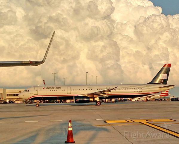 Airbus A321 (N578UW) - U.S Airways retro jet with a huge cloud behind!