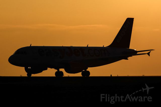 Airbus A319 (HB-JZO) - Sunset caption