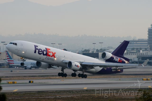 Boeing MD-11 (N573FE) - Early morning T.O.