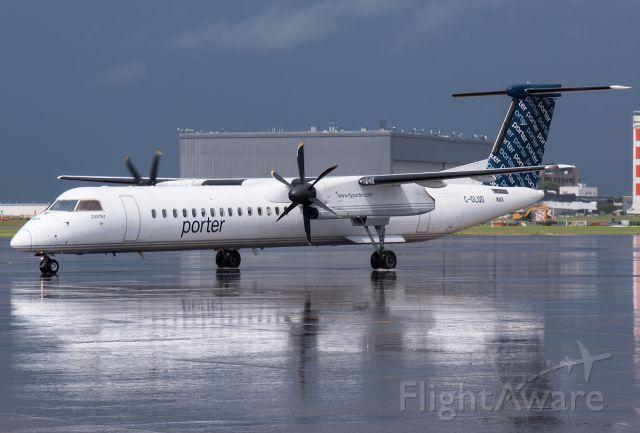 de Havilland Dash 8-400 (C-GLQD) - Rainstorm just finishing