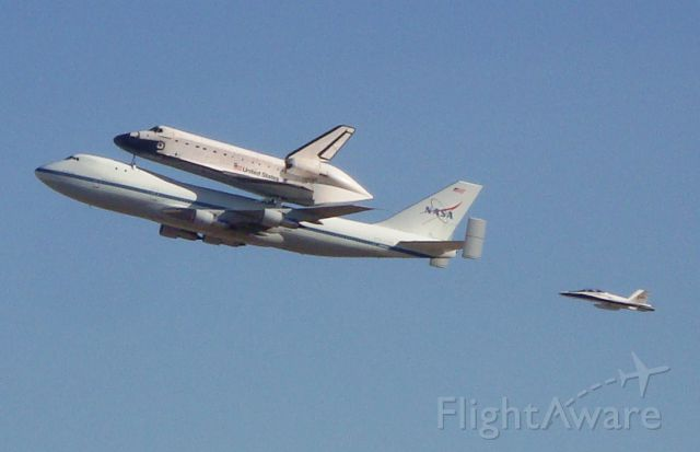 — — - NASA 747 (N905NA) with Endeavour (OV105) flying over Air Force Plant 42 in Palmdale where all the Orbiters were built with NASA843 (f18) phot/video chase.
