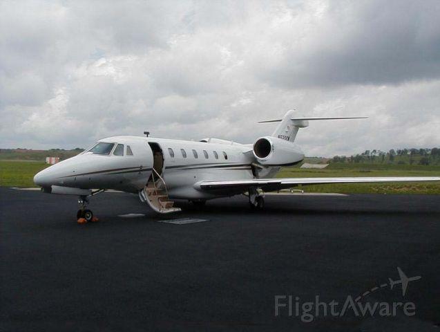 Cessna Citation X (N520CM) - CAREMARK PHARMACEUTICALS CITATION X OUTSIDE THEIR HANGER @ KBHM AIRPORT - JUL 2001