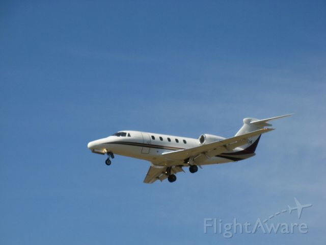 Cessna Citation III (N650CH) - Cessna Citation III on short final to runway 15 at Oswego County Airport after flight from KSTP (St. Paul, MN) on 4/10/09.