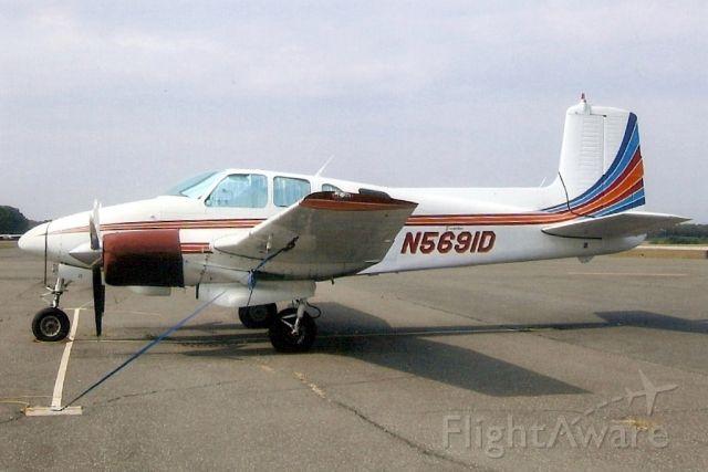 Beechcraft Twin Bonanza (N5691D) - Seen here in Sep-05.