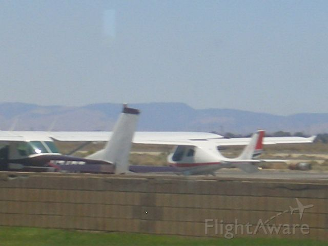 Cessna 152 (N74GT) - The 152 is parked in front of a light sport.
