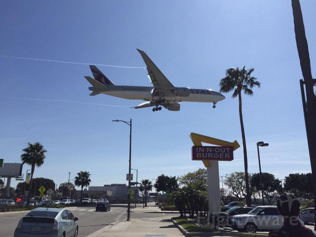 Boeing 777 — - I was standing right next to the In-N-Out Burger when I captured this plane coming into Los Angeles International Airport (LAX)