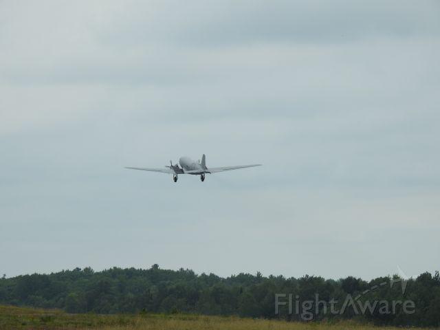 — — - DC-3 off and away at CYQA Muskoka Canada