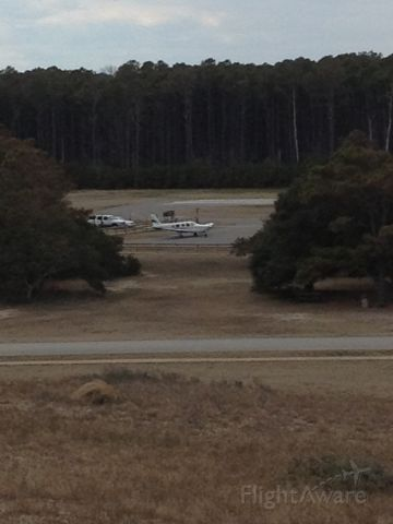 — — - A aircraft at KFFA first flight airport.  I think this place was going to Greensboro.