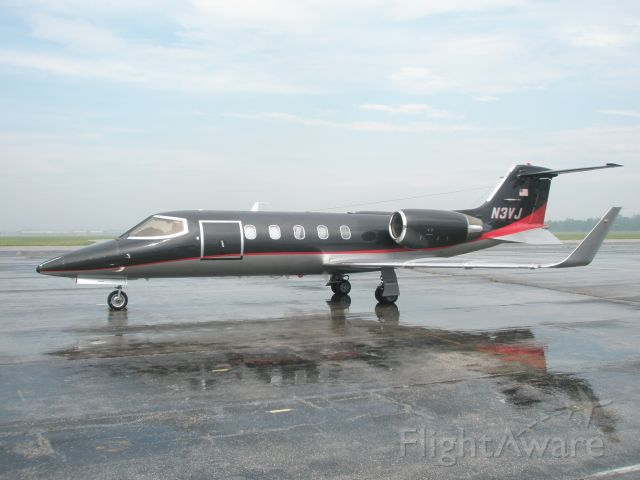 Learjet 31 (N3VJ) - Sitting on the ramp at Willow Run just after a morning shower.