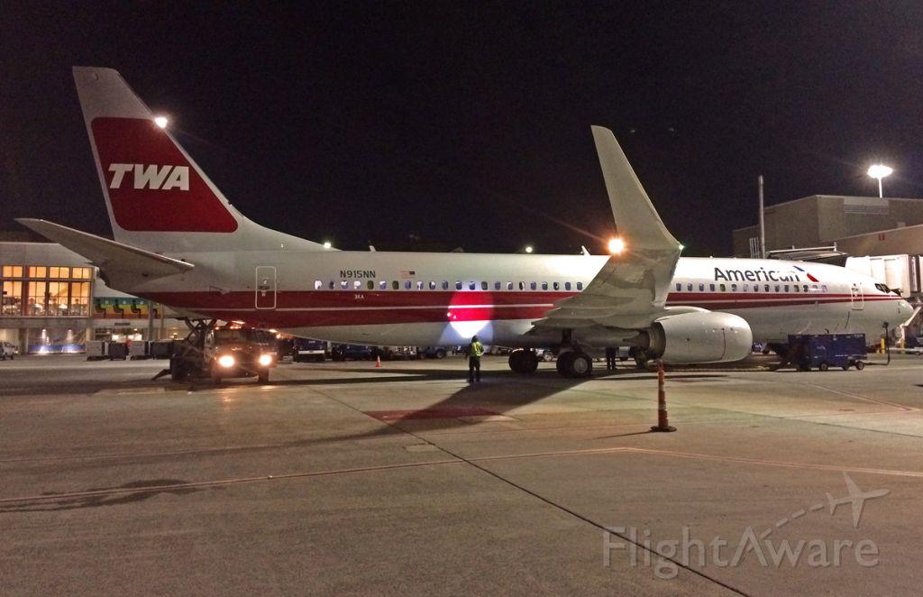 Boeing 737-800 (N915NN) - TWA Retro night shot @ KBOS Logan 1st visit 11/24/2015