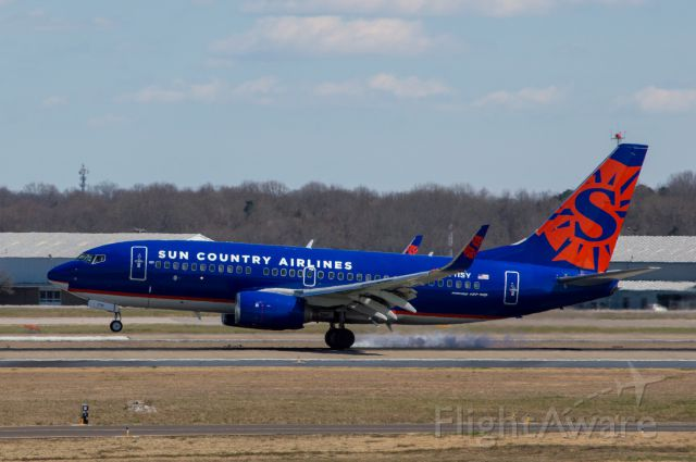 Boeing 737-700 (N711SY) - A Sun Country 737-700 smokes Nashville's Runway 2L. Photo token March 18, 2019 at 2:00 PM with Nikon D3200 at 200mm.