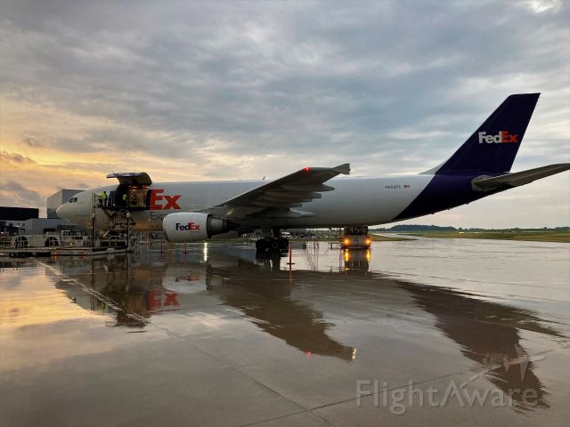 N650FE — - Avery wet cargo ramp area immediately after the summer storm.br /br /Flight 325 moments from departure for Madison WI & Memphis TN.