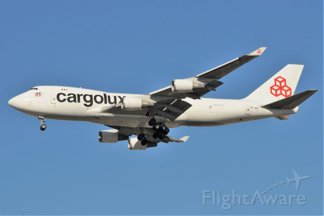 Boeing 747-400 (LX-JCV) - Shot this bird 5 months ago in the summer heat and haze at KIND. It was all white then. Nice looking with titles and tail logo, and much better lighting.