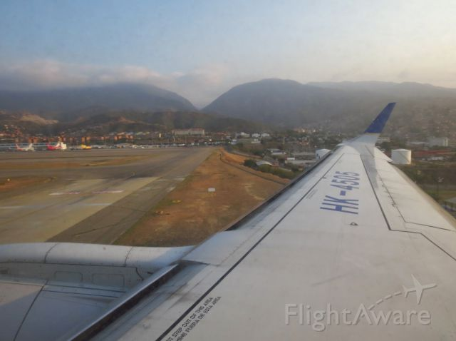 Embraer ERJ-190 (HK4505) - Seconds from touchdown Rwy 10.