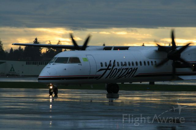 de Havilland Dash 8-200 (N420QX) - Taxing in on a typical wet seattle day
