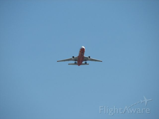 McDonnell Douglas DC-10 (N450AX) - Tanker 910 flying over my house just east of a mid-field approach to McClellan (KMCC)