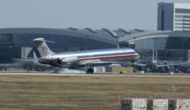 McDonnell Douglas MD-80 — - American Airlines MD-80 landing at KDFW. I liked the smoke in this shot.