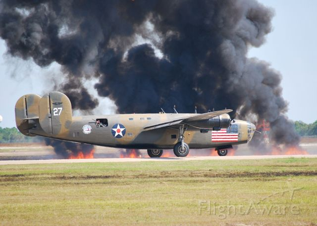 Consolidated B-24 Liberator (N24927) - Wings Over Houston Air Show. We were right on the runway after it landed. The field had caught fire from a pyrotechnic displayed.