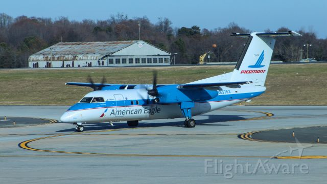de Havilland Dash 8-100 (N837EX) - Taken from the international terminal at Charlotte, this is the only Dh8A still in operation.