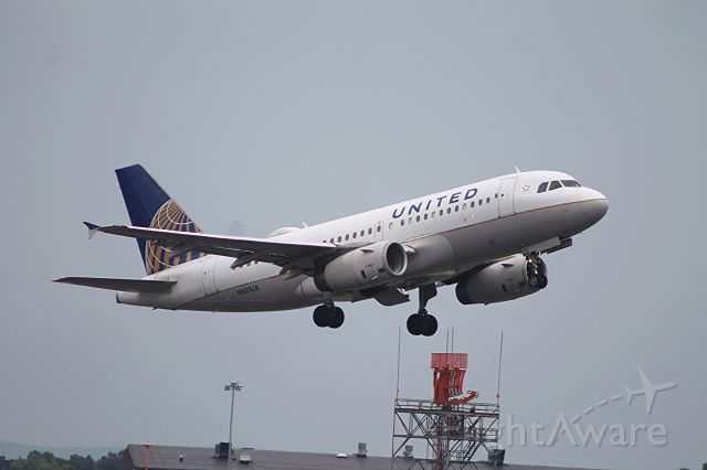 Airbus A319 (N801UA) - Gear in transit, off of 24